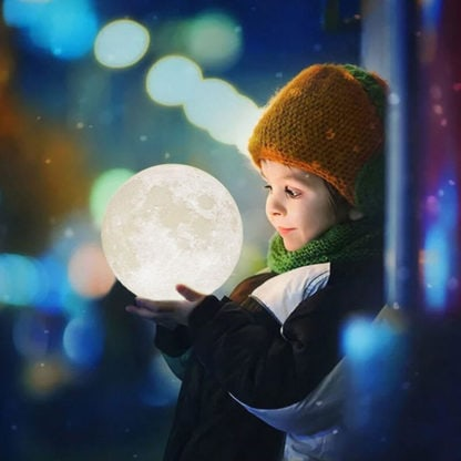 Girl using our moon lamp light 3D printed. Explore the universe and space with this home decor and moon toy.