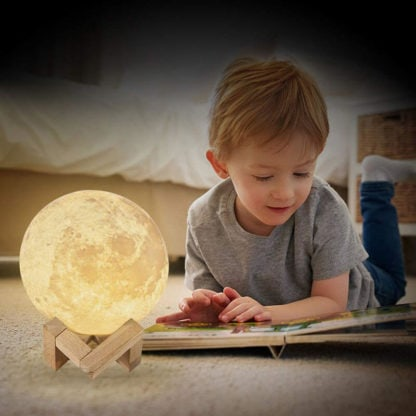 Child using our 3D printed moon lamp light.